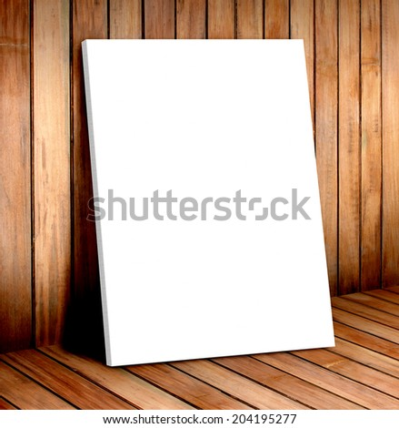 white poster frame in wooden room,mock up for your content - stock photo
