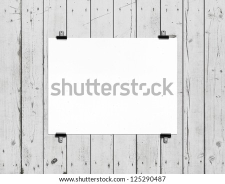 white poster on wooden wall - stock photo
