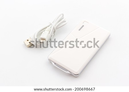 White Power bank, small device that have electricity to recharge many kind of smart phone via USB. - stock photo