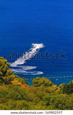 White power boat on the blue Adriatic sea, Montenegro - stock photo