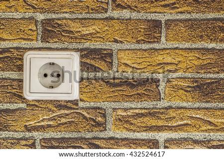 white power switch on the orange brick photo wallpaper background - stock photo