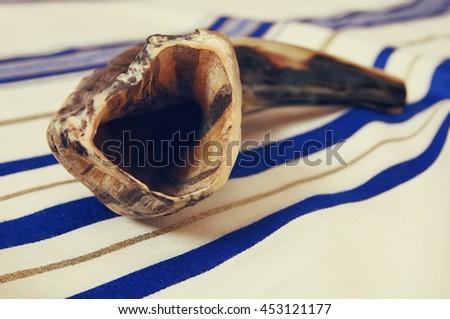 White Prayer Shawl - Tallit, and Shofar (horn). Jewish religious symbols - stock photo