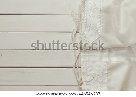 White Prayer Shawl - Tallit, jewish religious symbol - stock photo