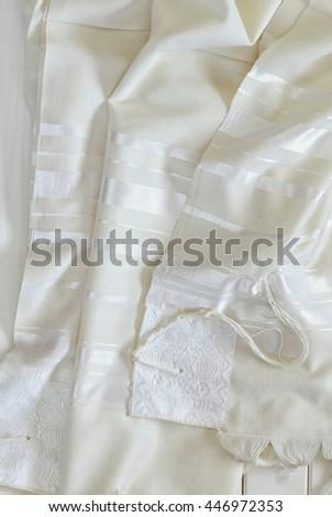 White Prayer Shawl - Tallit, jewish religious symbol. - stock photo