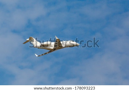 white private jet with against the blue sky - stock photo