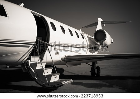 white private plane at the airport - stock photo