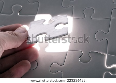 White puzzle on the table - stock photo