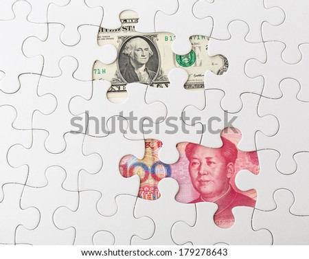 White puzzle with American dollar and chinese yuan - stock photo