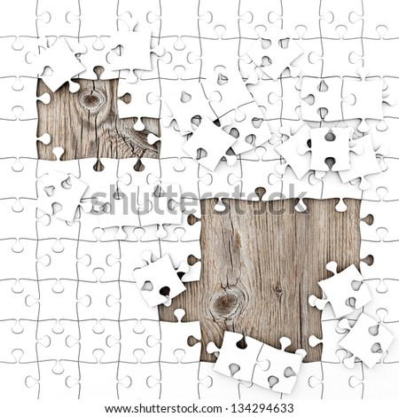 White Puzzle with Wooden Background - stock photo
