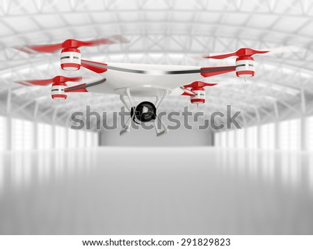 white quadcopter drone with HD camera in flight in interior warehouse - stock photo