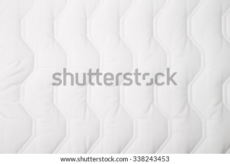 White quilt pattern, for backgrounds or textures - stock photo
