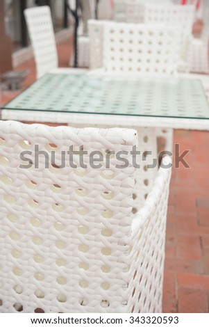 white rattan sofa and table sets in outdoor vertical composition - stock photo