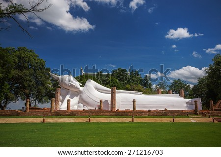 White reclining Buddha Image in Buddhist temple in Thailand - stock photo
