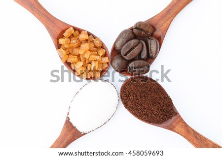 White, red sugar, coffee powder and coffee beans in wooden spoon on white background. - stock photo