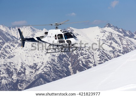 White rescue helicopter  in the mountains - stock photo
