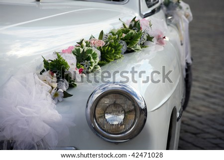 White retro car with flowers - stock photo