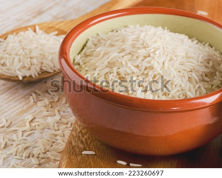 White Rice in a clay bowl. Selective focus - stock photo