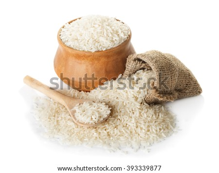 White rice  in bowl and a bag, a wooden spoon isolated on a white background closeup - stock photo