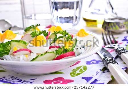 White rice with raw vegetables and boiled eggs - stock photo