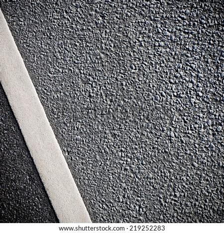 White road line on asphalt - stock photo