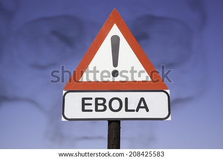 White road warning triangle with black  exclamation point and red frame on  a wooden mast in front of a blue sky. A second rectangular sign warns in english about ebola - stock photo