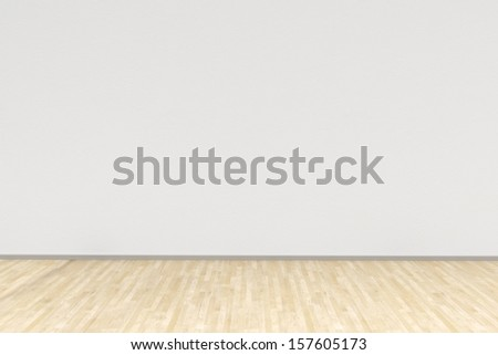 White room with hardwood floor as background - stock photo