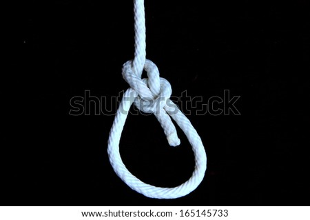 White rope with hangman's noose isolated on black background.  - stock photo