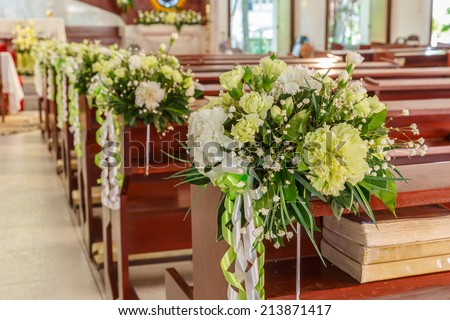 white roses and carnations flower wedding decoration in a church - stock photo