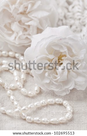 White roses and pearl necklace - stock photo