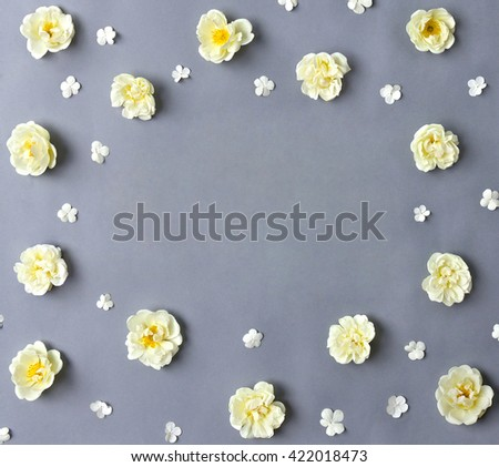 White roses (Burnet double white, shrub rose) and flowers viburnum on a gray background with space for text  - stock photo