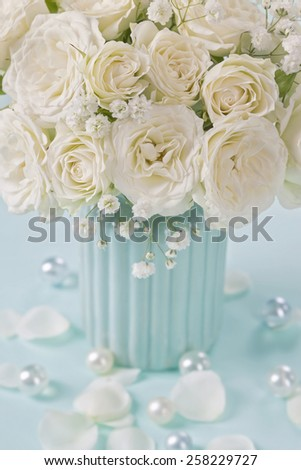 White roses in a blue vase - stock photo