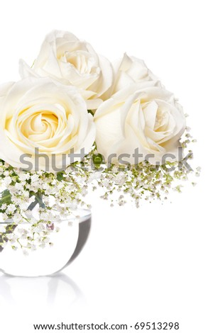 White roses in a vase with water on a white background - stock photo