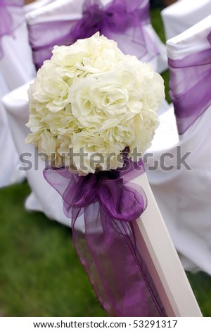 White roses wedding bouquet with violet ribbon - stock photo