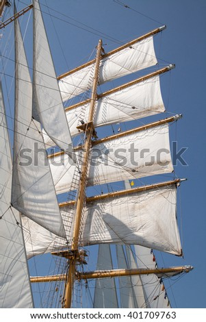 White sails of an old sailing ship - stock photo