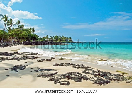 White sand beach on Hawaii Big Island with azure ocean in background - stock photo