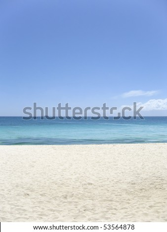 white sand blue sea and clear sky of boracay island in the philippines - stock photo