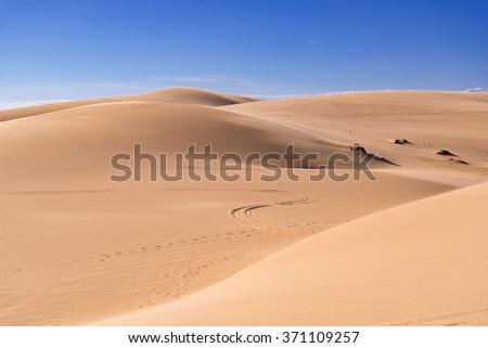White Sand Dunes in Mui Ne, Phan Thiet, Vietnam. Popular tourist attraction - stock photo