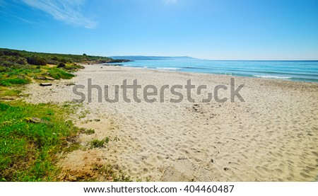 white sand in Le Bombarde beach, Italy - stock photo