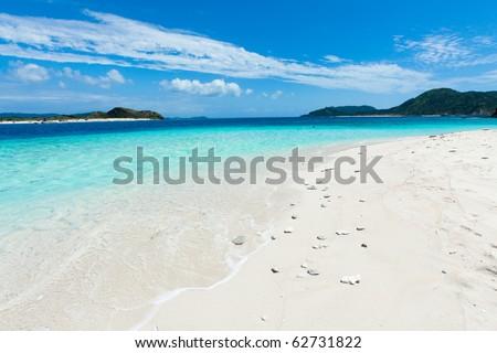 White sand paradise beach on the deserted tropical island in the coral reef lagoon with clear blue sea, Gahi Island of Kerama Islands, Okinawa, Japan - stock photo