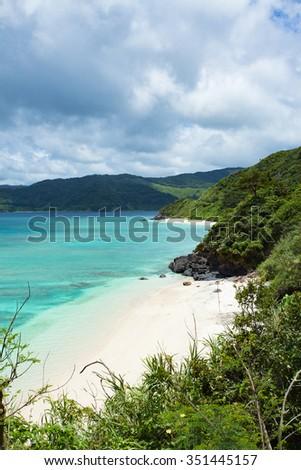 White sand tropical beach with clear blue lagoon water, Amami Oshima Island, Japan - stock photo
