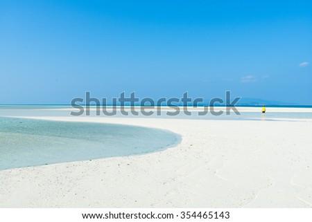 White sand tropical beach with clear blue sky, Okinawa, Japan - stock photo