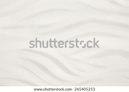 White sand with waves for a summer holiday background. - stock photo