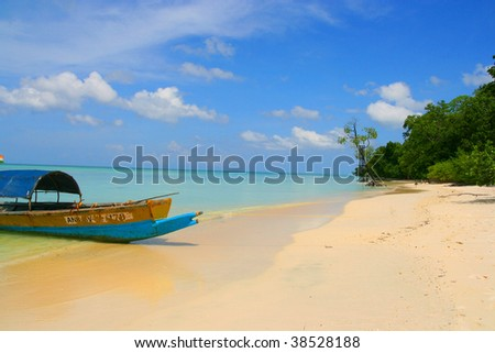 White sands beach and longtail boat - andaman island - stock photo