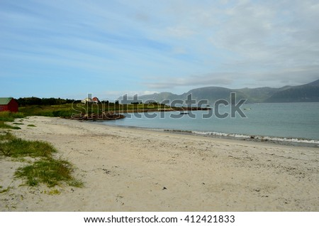 White sandy beach in summertime - stock photo