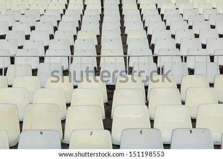 white seats in the sports hall - stock photo