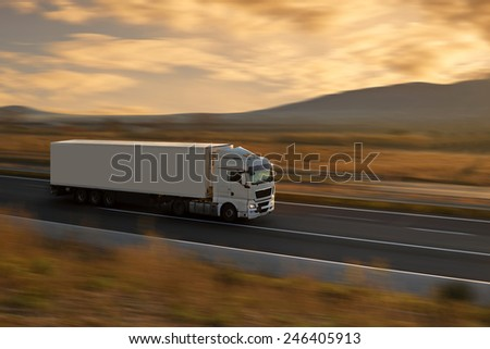 white semi truck on highway - stock photo
