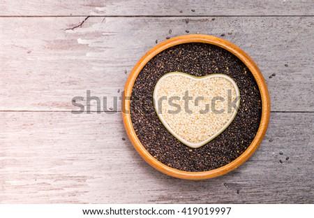 White sesame and black sesame seed ,heart shape - stock photo
