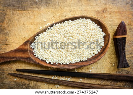 White sesame in the spoon - stock photo