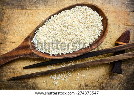 White sesame in the wooden eat wear  - stock photo