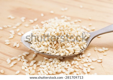 White sesame seeds on a wooden - stock photo